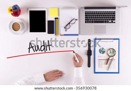 Business Concept: Businessman writing the words AUDIT - stock photo