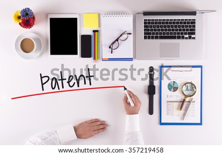 Business Concept: Businessman writing the words PATENT - stock photo