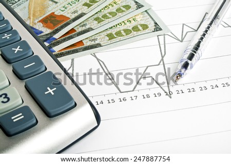 Business concept - calculator, money and pen - stock photo
