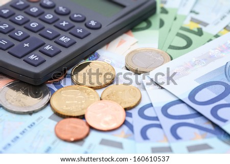 Business concept. Calculator on European Union Currency closeup background