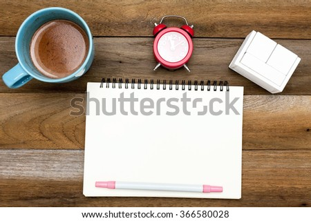 Business concept: Chocolate mug,red clock,blank space diary,blank wooden block calendar and pen on wooden blackground - stock photo