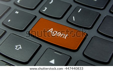 Business Concept: Close-up the Agent button on the keyboard and have Orange color button isolate black keyboard
