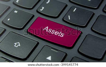 Business Concept: Close-up the Assets button on the keyboard and have Magenta color button isolate black keyboard