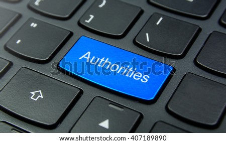 Business Concept: Close-up the Authorities button on the keyboard and have Azure, Cyan, Blue, Sky color button isolate black keyboard - stock photo