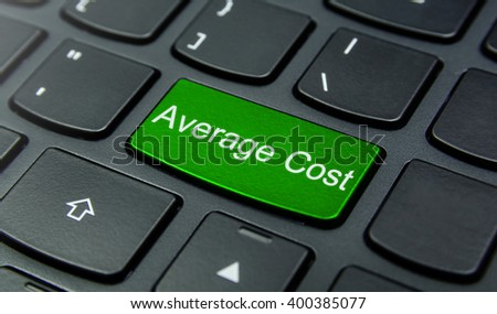 Business Concept: Close-up the Average Cost button on the keyboard and have Lime, Green color button isolate black keyboard