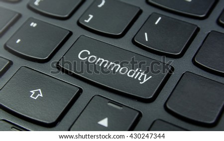 Business Concept: Close-up the Commodity button on the keyboard and have Black color button isolate black keyboard - stock photo