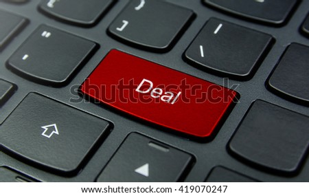 Business Concept: Close-up the Deal button on the keyboard and have Red color button isolate black keyboard