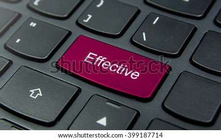 Business Concept: Close-up the Effective button on the keyboard and have Magenta color button isolate black keyboard