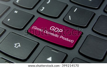 Business Concept: Close-up the GDP (Gross Domestic Product) button on the keyboard and have Magenta color button isolate black keyboard