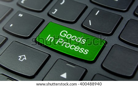 Business Concept: Close-up the Goods In Process button on the keyboard and have Lime, Green color button isolate black keyboard
