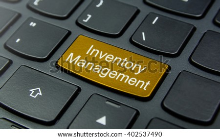 Business Concept: Close-up the Inventory Management button on the keyboard and have Gold, Yellow color button isolate black keyboard - stock photo