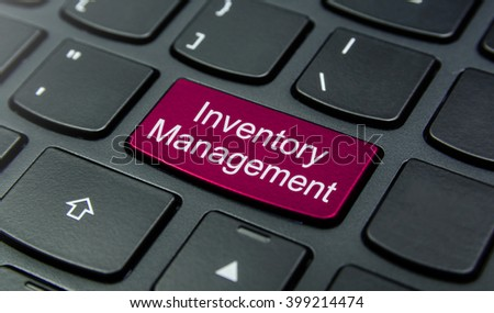 Business Concept: Close-up the Inventory Management button on the keyboard and have Magenta color button isolate black keyboard - stock photo