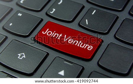 Business Concept: Close-up the Joint Venture button on the keyboard and have Red color button isolate black keyboard