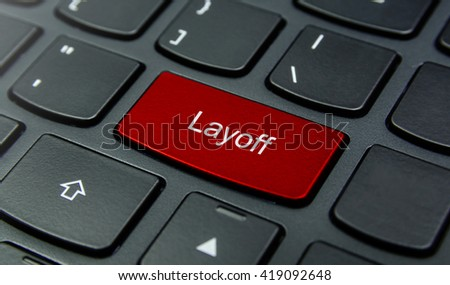 Business Concept: Close-up the Layoff button on the keyboard and have Red color button isolate black keyboard - stock photo