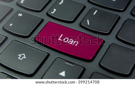 Business Concept: Close-up the Loan button on the keyboard and have Magenta color button isolate black keyboard
