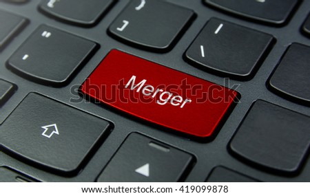Business Concept: Close-up the Merger button on the keyboard and have Red color button isolate black keyboard - stock photo