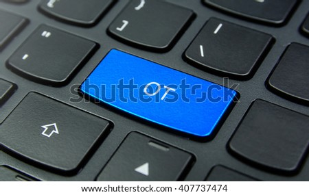 Business Concept: Close-up the OT button on the keyboard and have Azure, Cyan, Blue, Sky color button isolate black keyboard