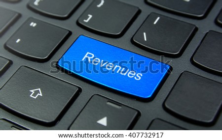 Business Concept: Close-up the Revenues button on the keyboard and have Azure, Cyan, Blue, Sky color button isolate black keyboard