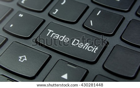 Business Concept: Close-up the Trade Deficit button on the keyboard and have Black color button isolate black keyboard
