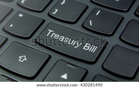 Business Concept: Close-up the Treasury Bill button on the keyboard and have Black color button isolate black keyboard - stock photo
