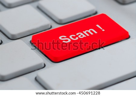 Business concept: computer keyboard with word Scam ! on enter button background