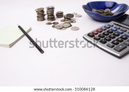 Business concept.  Counting money on calculator, stack of coins. Financial Accounting - money and calculator - stock photo
