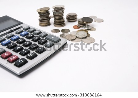 Business concept.  Counting money on calculator, stack of coins. Financial Accounting - money and calculator