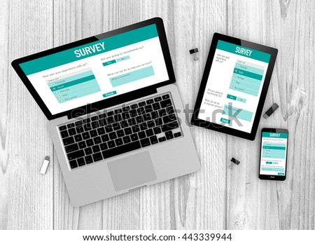 Business concept: Devices witn online customer service satisfaction survey on the screen. All graphics are made up. - stock photo