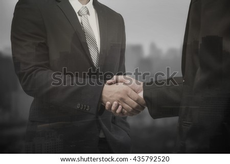 business concept,double exposure business man shaking hand - stock photo