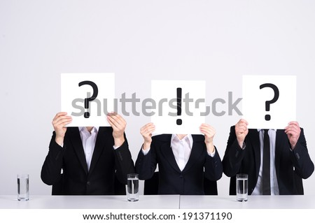 Business concept. Executives covering their faces with different signs - stock photo