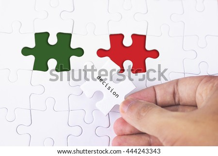 Business Concept - Female hand and missing puzzle with Decision word