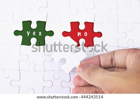 Business Concept - Female hand and missing puzzle with Yes and No word