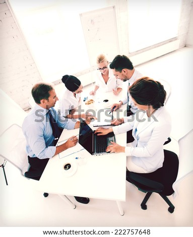 business concept - friendly business team having meeting in office - stock photo
