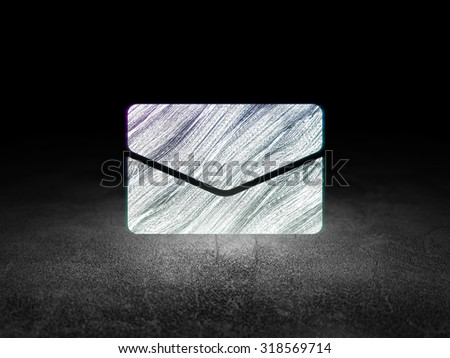 Business concept: Glowing Email icon in grunge dark room with Dirty Floor, black background - stock photo