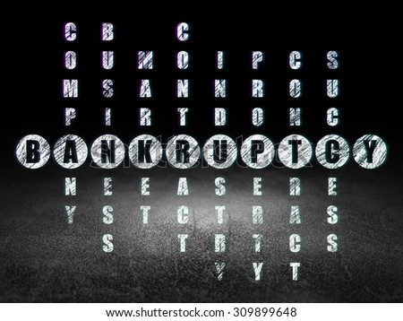 Business concept: Glowing word Bankruptcy in solving Crossword Puzzle in grunge dark room with Dirty Floor, black background - stock photo