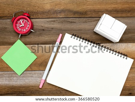 Business concept:Green blank post it,red clock,blank space diary,blank wooden block calendar and pen on wooden blackground - stock photo