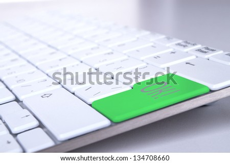 business concept, green enter button or key on white keyboard photography. - stock photo