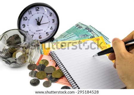 Business concept.Hand with pen, clock and money on white background. - stock photo