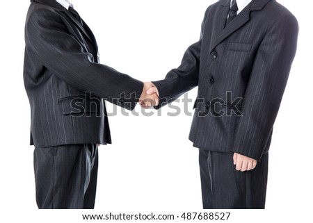 business concept - handshake of two little boys in business suits isolated on white background