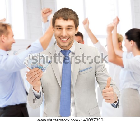 business concept - happy businessman with cash money in office - stock photo