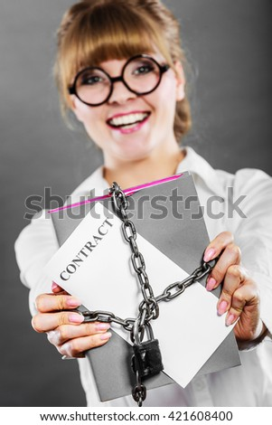 Business concept. Happy woman businesswoman holding in hands paper document contract chained with padlock - stock photo