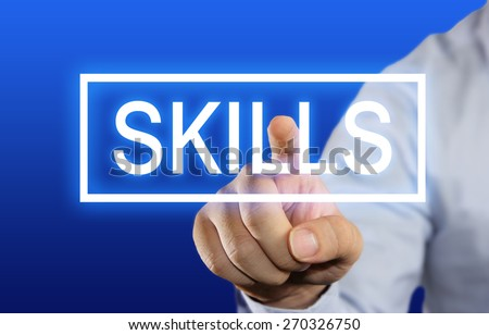 Business concept image of a businessman clicking Skills button on virtual screen over blue background