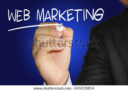 Business concept image of a businessman holding marker and write Web Marketing on blue background - stock photo