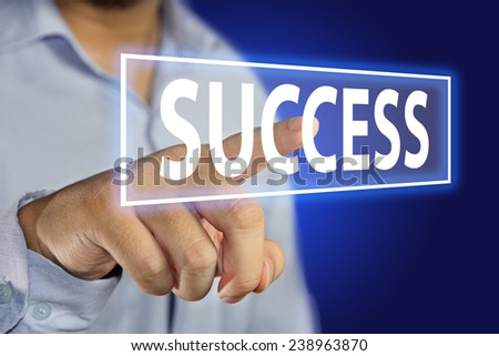 Business concept image of a businessman pointing Success icon on virtual screen over blue background - stock photo