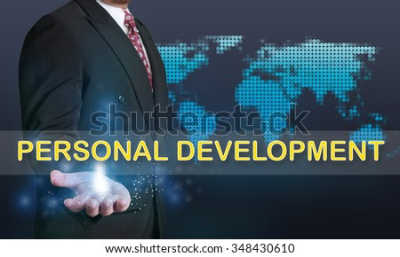 Business concept image of a businessman showing Personal Development words on his hand over blue background with dotted world map - stock photo
