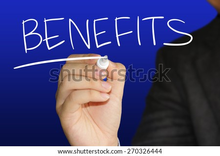 Business concept image of a hand holding marker and write Benefits over blue background - stock photo