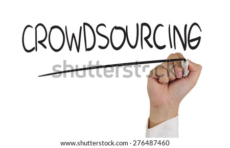 Business concept image of a hand holding marker and write Crowdsourcing isolated on white - stock photo