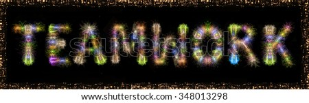 Business concept image of Teamwork message written with sparkle fireworks on black sky / background