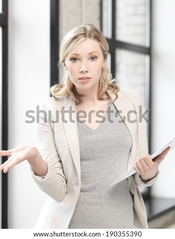 business concept - indoor picture of worried woman with documents - stock photo