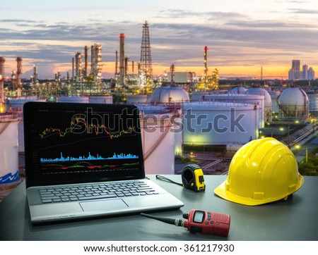 Business concept, industry. Laptop desk on with Oil and gas industry background - stock photo